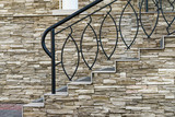 Fragment of modern stairs design, porch with metal railings and trim stone - 176341644