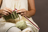 Knitting with green color knitting needles