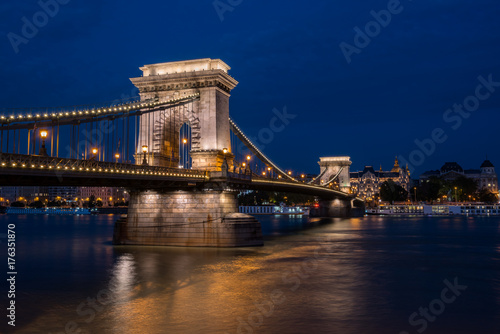 Beautiful night shot of the illuminated Chain Bridge in Budapest across the Danube river in Hungary Poster