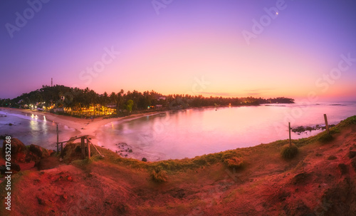 Papiers peints Rose clair / pale Tropical beach on sunset