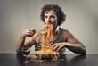 Greedy man eating spaghetti