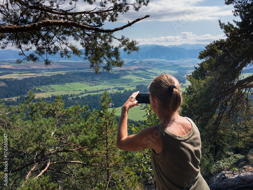 The woman taking landscape photo with mobile phone, Liptov, Slovakia