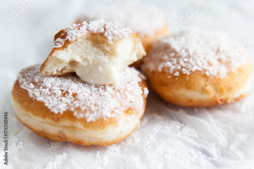 Deep-fried doughnuts filled with coconut custard cream Poster