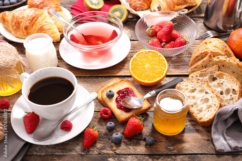 Wall mural continental breakfast with coffee,tea,fruit and bread