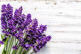 Fresh flowers of lavender bouquet, top view on white wooden background - 176370239