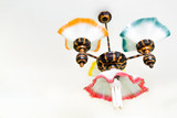Retro chandelier with energy efficient bulb hanging under ceiling