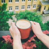 Close-up shot of woman hands holding vintage coffee mug - 176372229