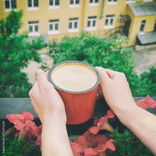Close-up shot of woman hands holding vintage coffee mug