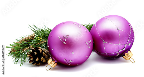 Christmas decoration lilac magenta balls with fir cones and fir tree branches isolated