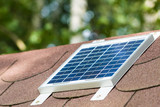 Small photovoltaic battery on bower roof, alternative energy. - 176382657