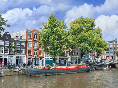 Deurstickers Amsterdam House boat at the ancient Amsterdam canal belt, The netherlands