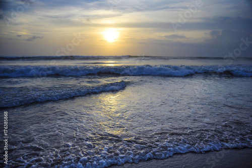 Fotobehang Bali Amazing beautiful sea landscape sunset view of Seminyak Double Six beach in Bali island of Indonesia