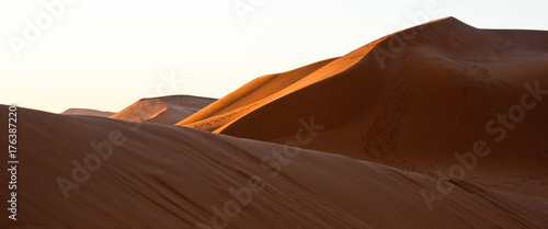 Foto op Canvas Marokko A game of shadows in the sand dunes of the desert at dawn