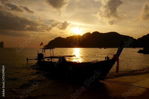 Longtail boats at sunset Poster