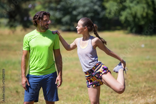 Fotobehang Fitness Smiling couple stretching outdoors