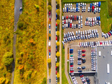 Aerial view of parking lot with cars. Industrial background on transportation theme.  - 176403411