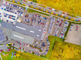 Aerial view of parking lot with cars. Industrial background on transportation theme.  - 176403434