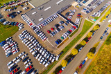 Aerial view of parking lot with cars. Industrial background on transportation theme.  - 176403461