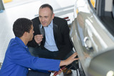 mechanic with client at auto service - 176407436