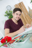young man working on architectural project - 176410294