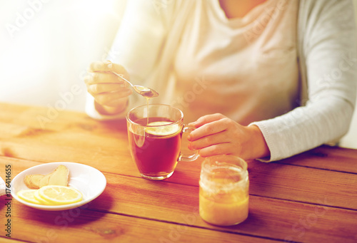 close up of ill woman drinking tea with lemon Poster