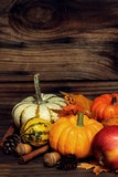 Autumn background with harvest vegetables and fruits on dark rustic wooden frame - 176420419