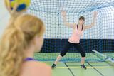 Woman defending handball goal - 176428407