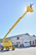 Quadro worker on construction crane yellow