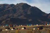 View of the village at mountains of Altai Republic, Russia. - 176433612