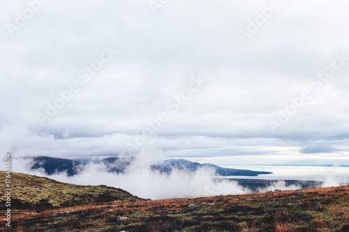 Papiers peints Cappuccino Natural Autumn Tundra Mountain Landscape in the Mountains-Hills with Clouds and Views of the Bay on the Kola Peninsula near the Town of Kandalaksha in Russia