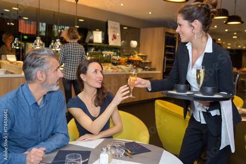 waitress serving the clients