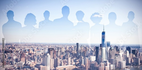 Composite image of silhouettes standing Poster
