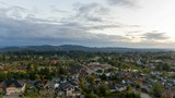 UHD 4k time lapse of clouds and sunset over suburban residential homes in Happy Valley Oregon early Fall Season 3840x2304 - 176451270