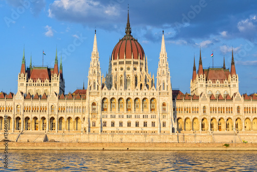 Fotobehang Boedapest The symmetrical main facade and the central dome of the Hungarian Parliament Building overlook the River Danube - Budapest, Hungary