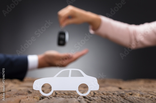 Close-up Of A White Car On Wooden Desk