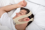 Man Sleeping With Anti Snoring Bandage - 176468415