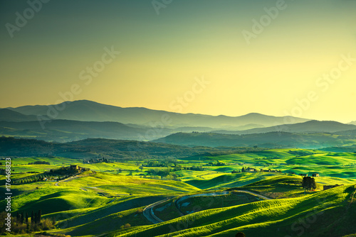 Deurstickers Toscane Volterra panorama, rolling hills, trees and green fields at sunset. Tuscany, Italy