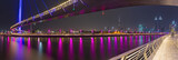 Dubai - The evening skyline with the bridge over the new Canal and Downtown. - 176470237