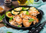 Chicken fillet with zucchini cooked on grill. - 176474089