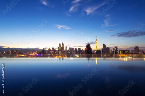 tranquil pool with modern buildings in midtown of modern city Poster