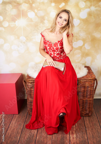 Plakát Young woman in long red dress
