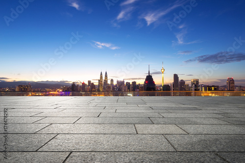 empty marble floor with cityscape of modern city Poster