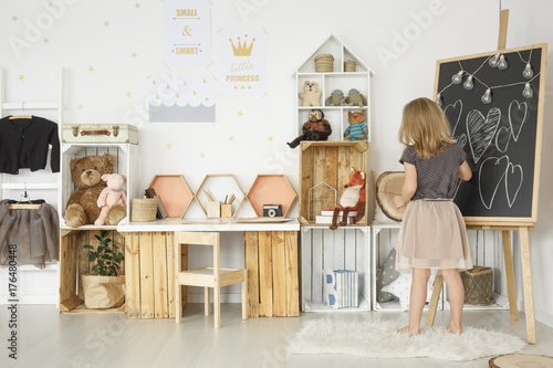 Girl in bright scandi room - 176480448