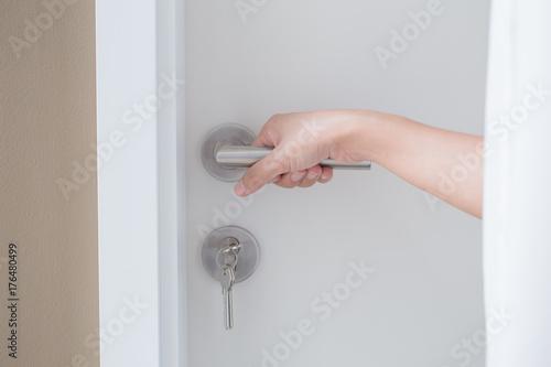 closeup hand hold door knob for open the door or close the door concept Poster
