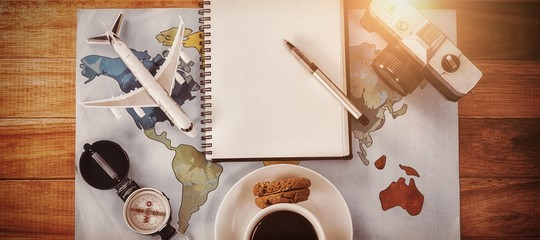 Overhead view of coffee cup with camera and diary map © vectorfusionart