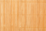 Bright fragment of wooden mat, abstract texture