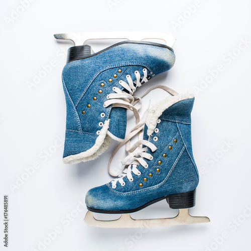 Old women's skates on a white background Poster
