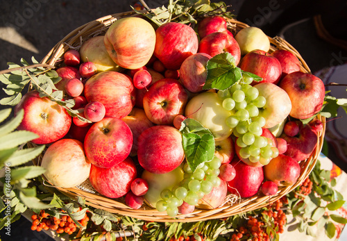 ripe apples with grapes in a basket