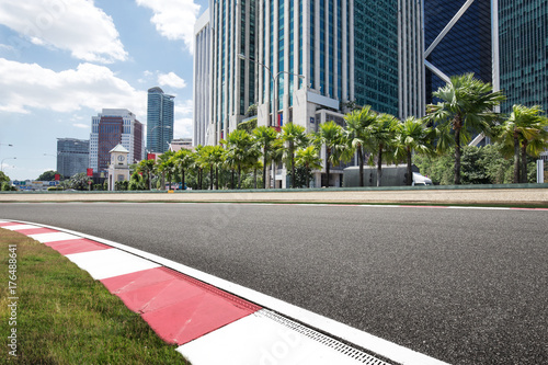 empty asphalt road with modern buildings Poster