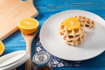 Traditional Belgium waffles and orange